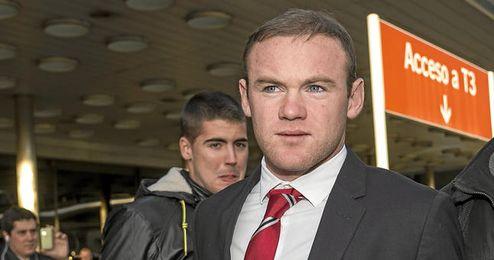 Wayne Rooney en uno de los viajes del Manchester United.