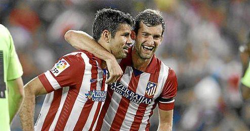 Leo Baptistao celebra un gol junto a Diego Costa en el partido ante Osasuna.