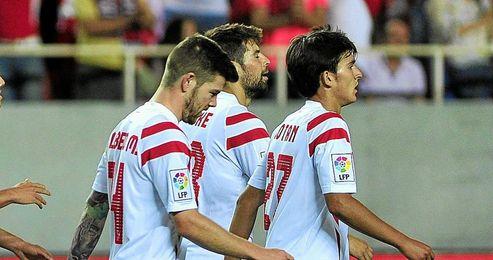 Cotán, junto a Alberto Moreno y Coke.