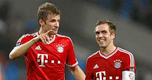 Müller y Lahm durante un partido con su equipo en esta temporada