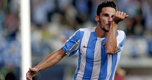 Juan Carlos celebrando un gol con el Málaga.