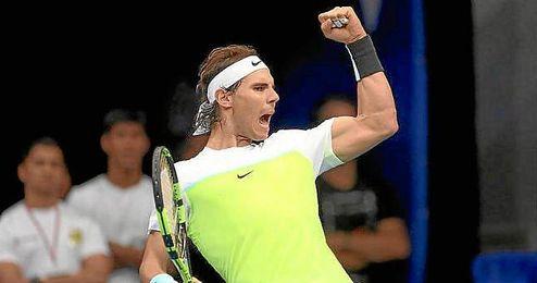 Rafa Nadal celebra su triunfo ante Raonic.