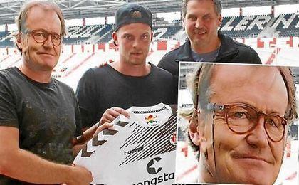 El entrenador del Sankt Pauli se pierde una presentación, pero le reemplaza un desconocido con careta
