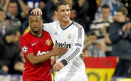 CR7 y Evra durante un partido entre United y Real Madrid