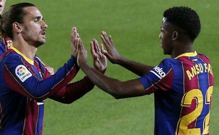 Griezmann y Ansu Fati, durante un partido con el Barcelona.